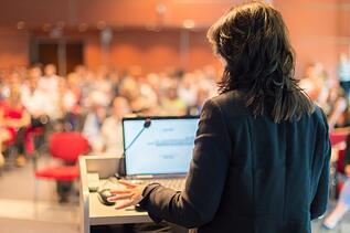 business-woman-lecturing-conference.jpg