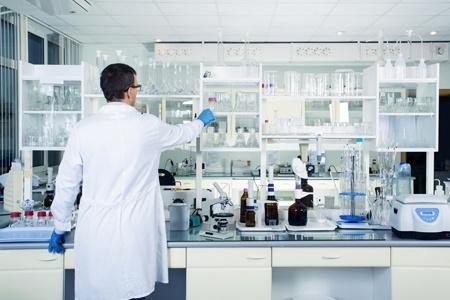 clean modern white medical or chemical laboratory. male chemist..jpg
