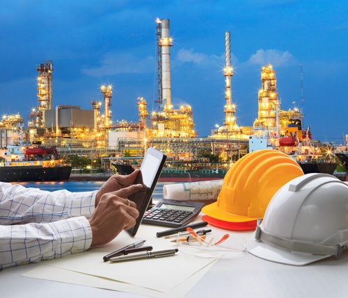 engineering-working-on-computer-tablet-against-beautiful-oil-refinery-small.jpg