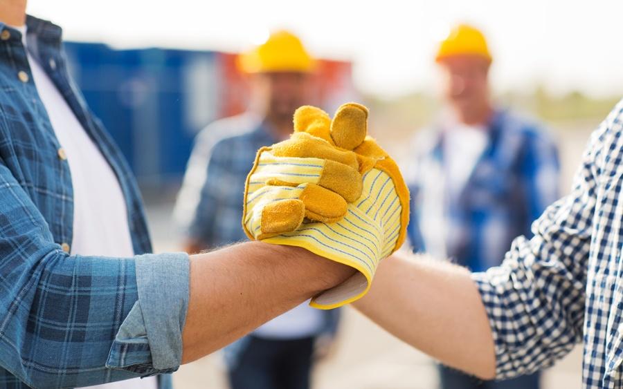 teamwork-handshake-gloves-workers.jpg