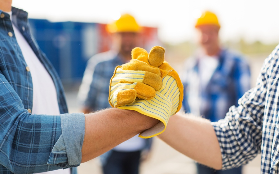 teamwork-handshake-gloves-workers.jpg