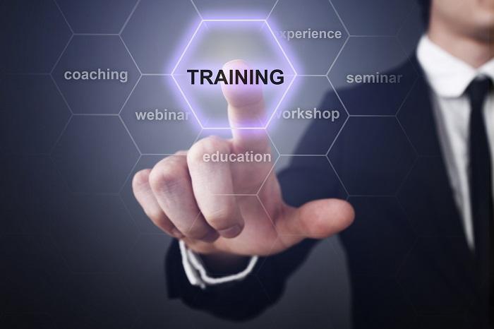 business man pressing training button