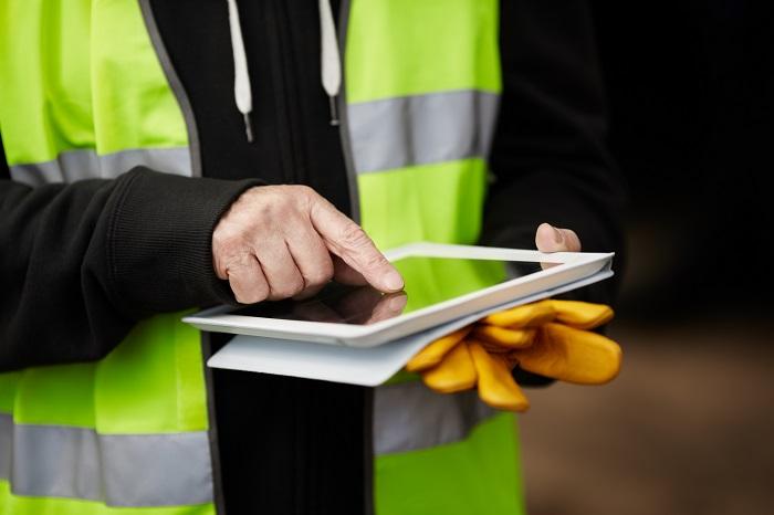 construction worker using digital tablet