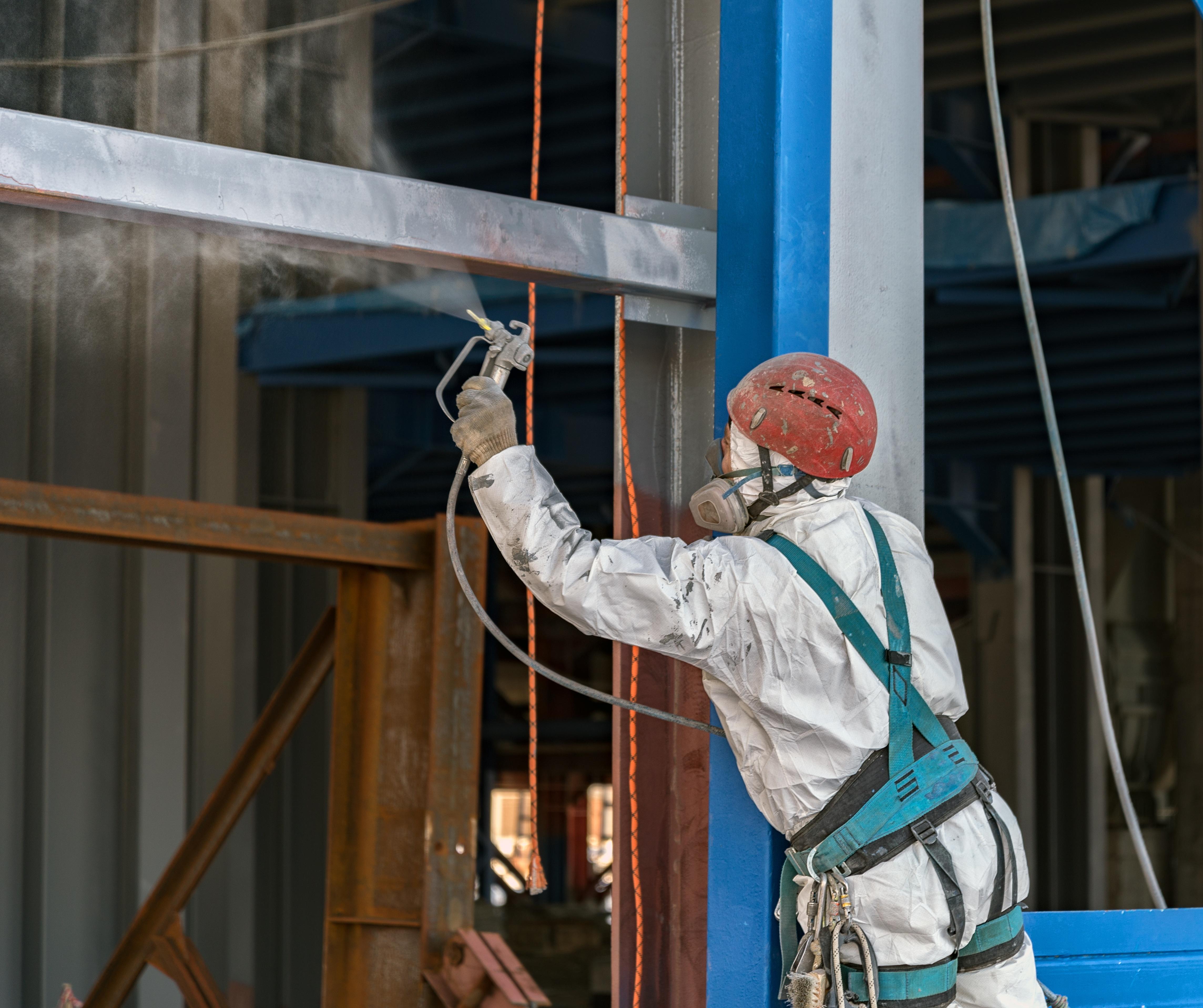 Applying an aerosol coating to metal.