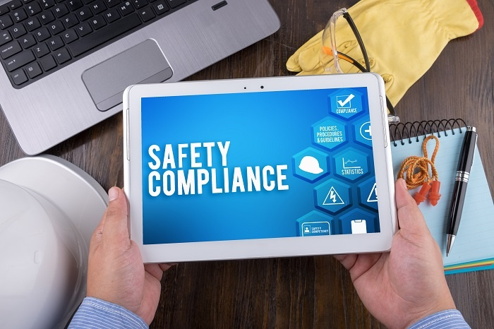 safety compliance software on mobile tablet device
