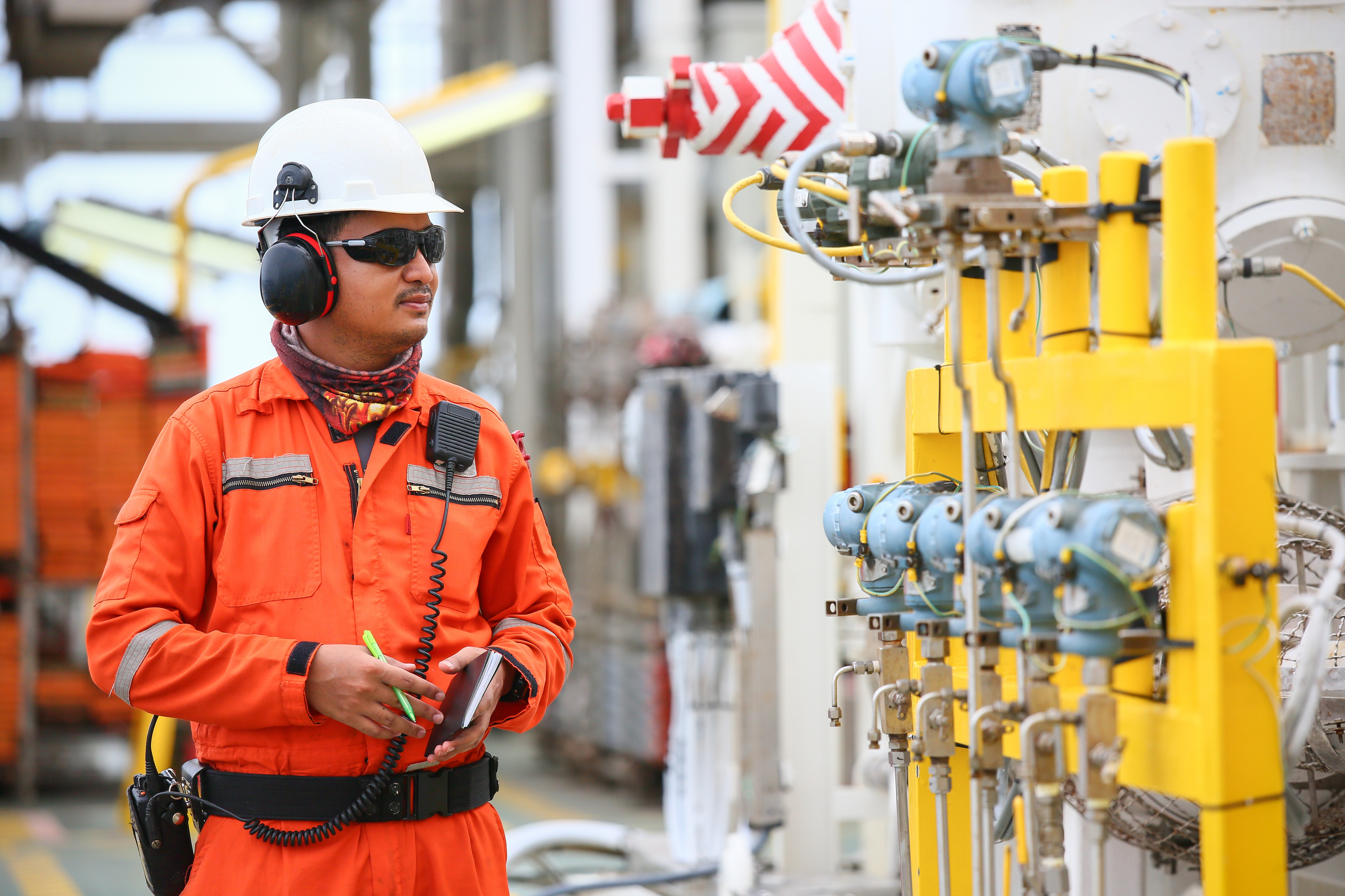 An OSHA safety inspection wearing PPE.