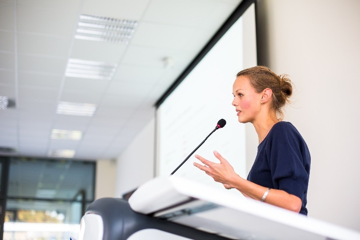 speaker-conference-female-gesturing.jpg